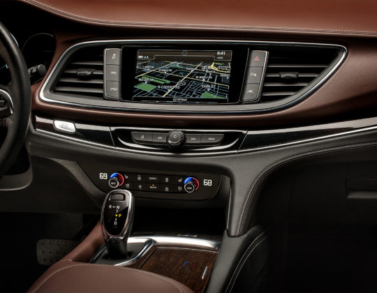 Model year 2018 Buick Enclave Avenir center stack featuring chestnut leather dash.