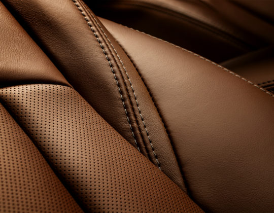 Model year 2018 Buick LaCrosse Avenir premium chestnut leather seat stitch detail.